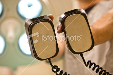 stock-photo-10681830-defibrillator-paddles-from-a-patient-s-perspective