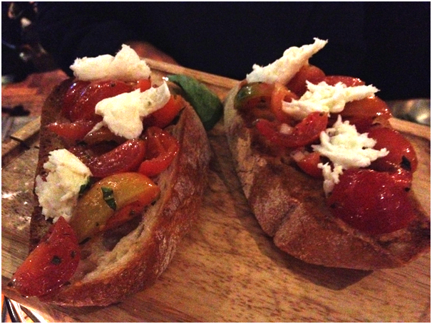 Bruschette: Caprese ($9.90) - cherry tomatoes, basil, red onion, garlic, origano, olive oil, D.O.P buffalo mozzerella