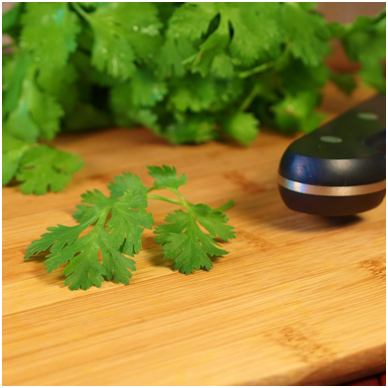 Cilantro or Chinese parsley.  When selecting cilantro for your dish, look for bright green leaves free of discoloration or spots.  Wash the cilantro well under cold running water, drain, cut off the stems and then give it a coarse chop