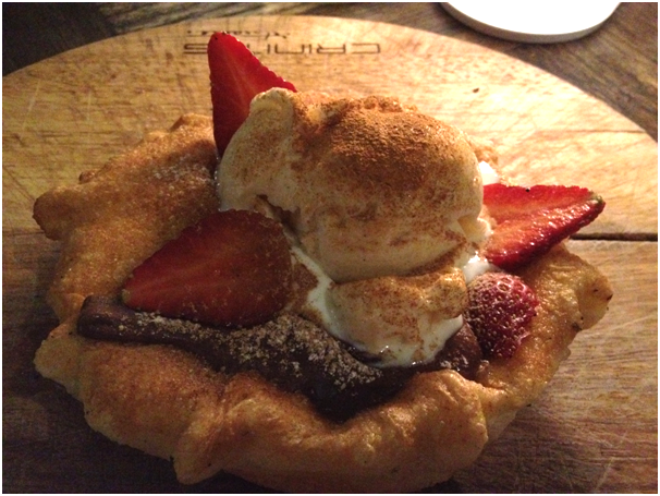 Dolci: Nutella Bomba ($16) - cinnamon coated fried pizza pocket filled w/ nutella served w/ vanilla gelato