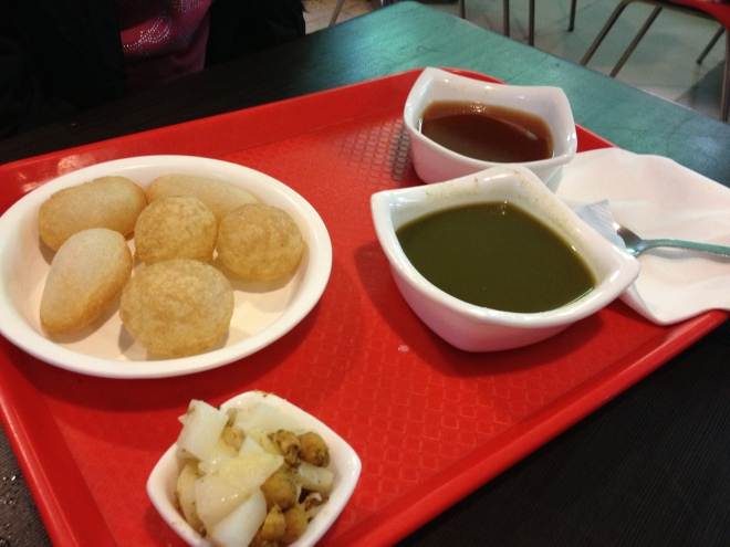 Pani Puri - Also known as fried thin hollow crisps which you break in the centre with your thumb, fill with unflavoured boiled potato pieces and dip in sweet and savoury sauce together - does that not sound perfect....