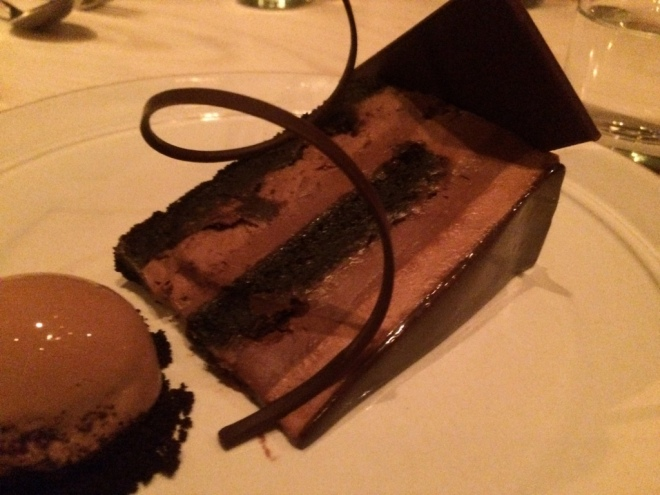 The richest most decadent chocolate gateau with a chocolate ice cream quenelle on the side